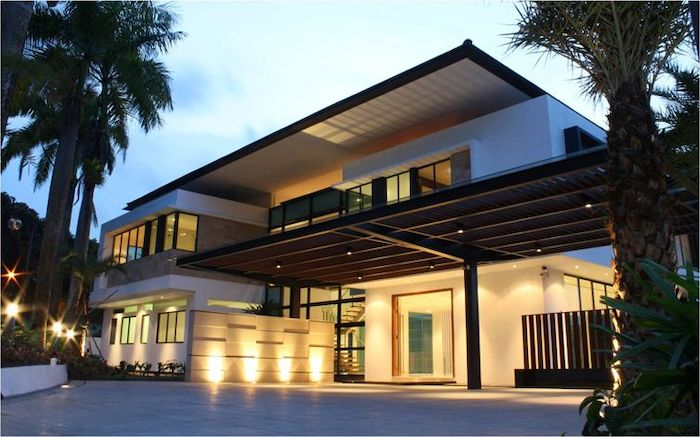 tall palm trees, front door decor ideas, large house, wooden columns, lights on the ceiling