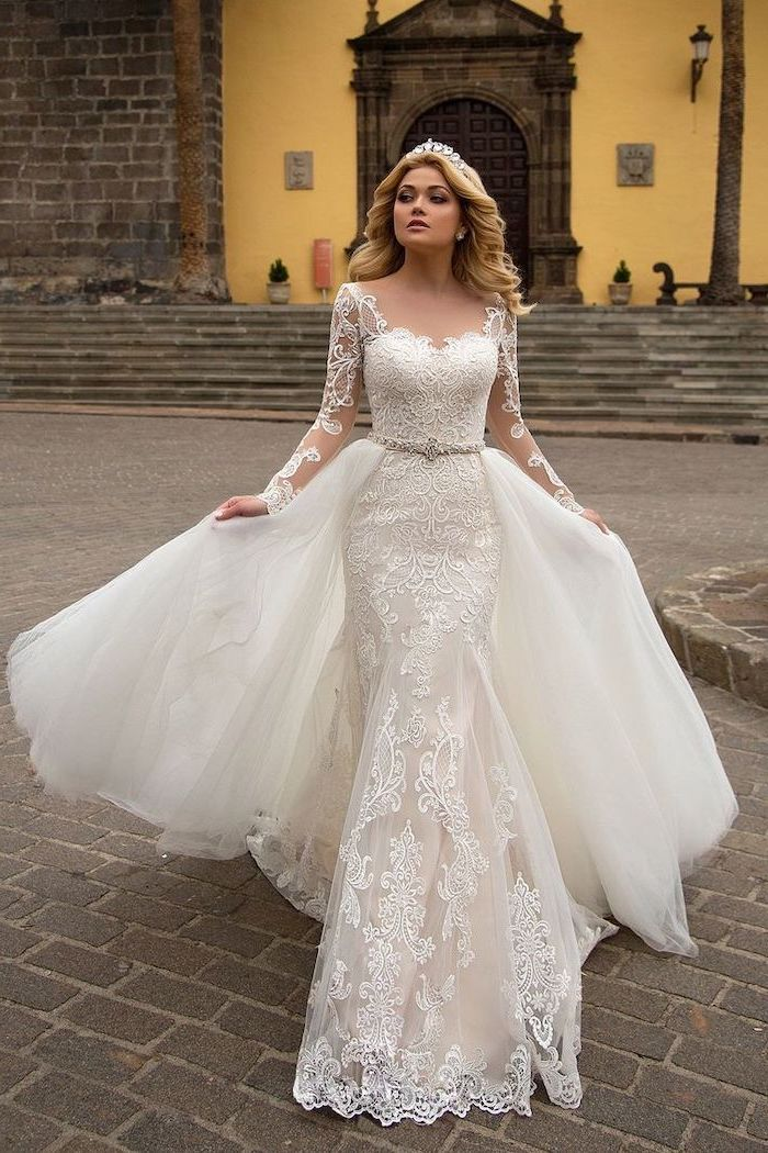fit and flare wedding dress, white dress, made of lace and tulle, long blonde wavy hair, crystal tiara