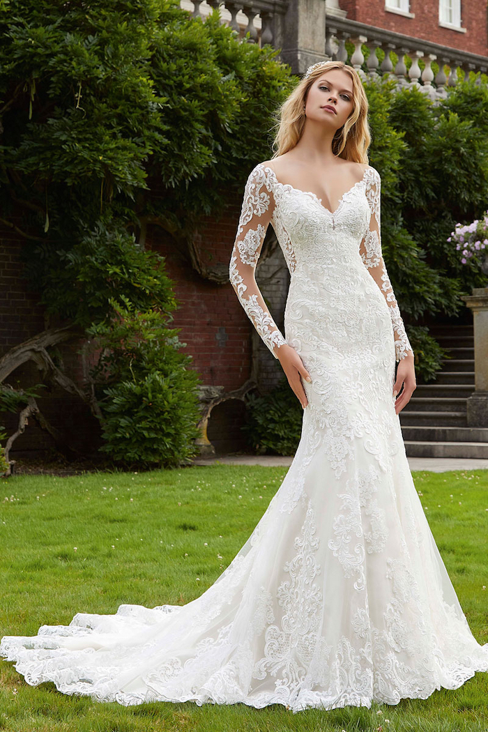 long blonde wavy hair, lace dress, long train, v neckline, fit and flare wedding dress