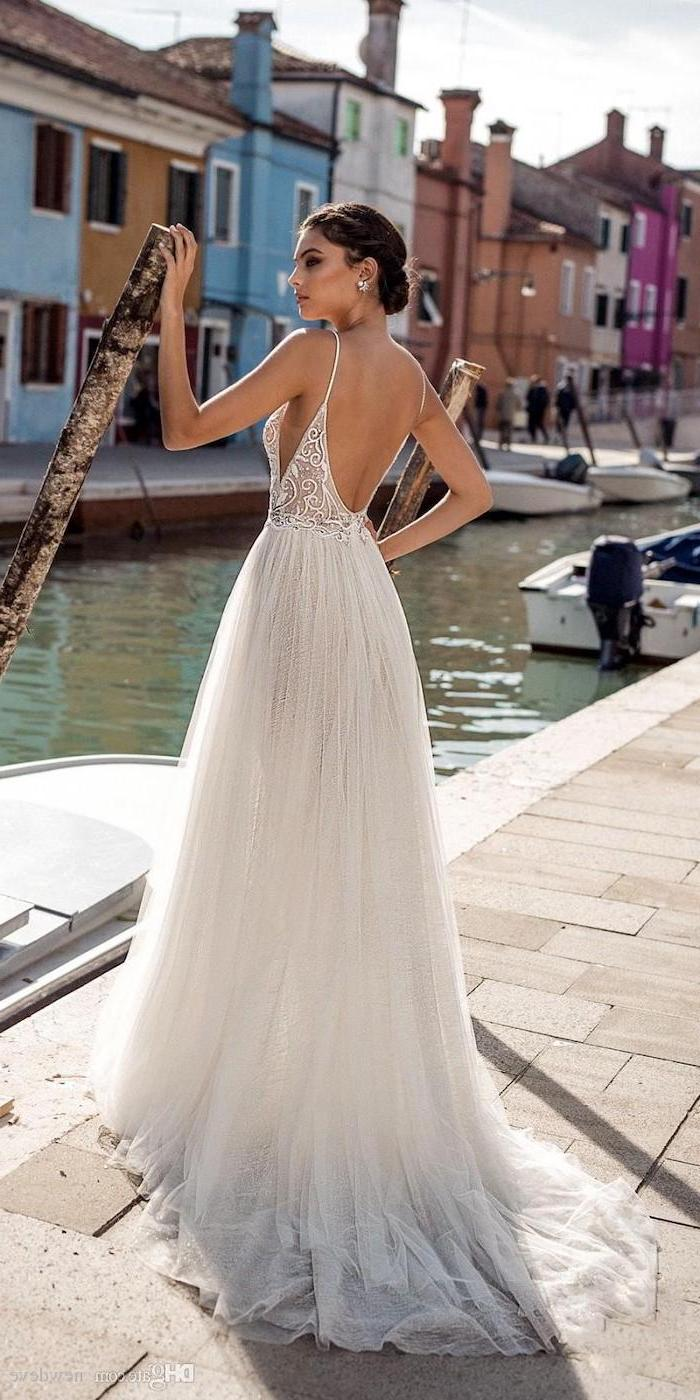 long tulle dress, open back, short beach wedding dresses, brown hair, in a low updo