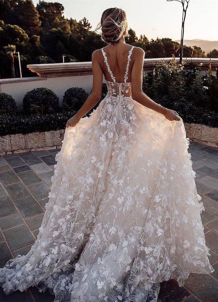 long lace train, spaghetti straps, beach wedding gowns, open back, blonde hair, in a low updo