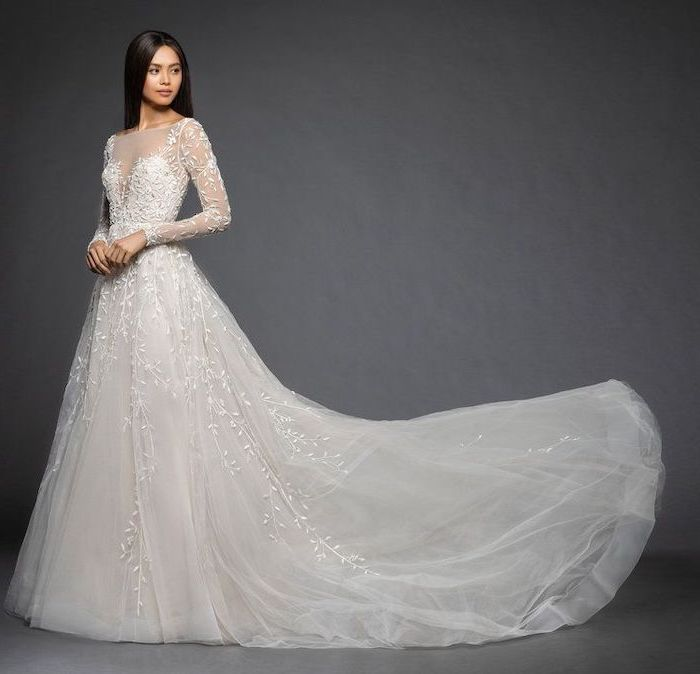 grey background, black straight hair, long train, tulle and lace, form fitting wedding dresses