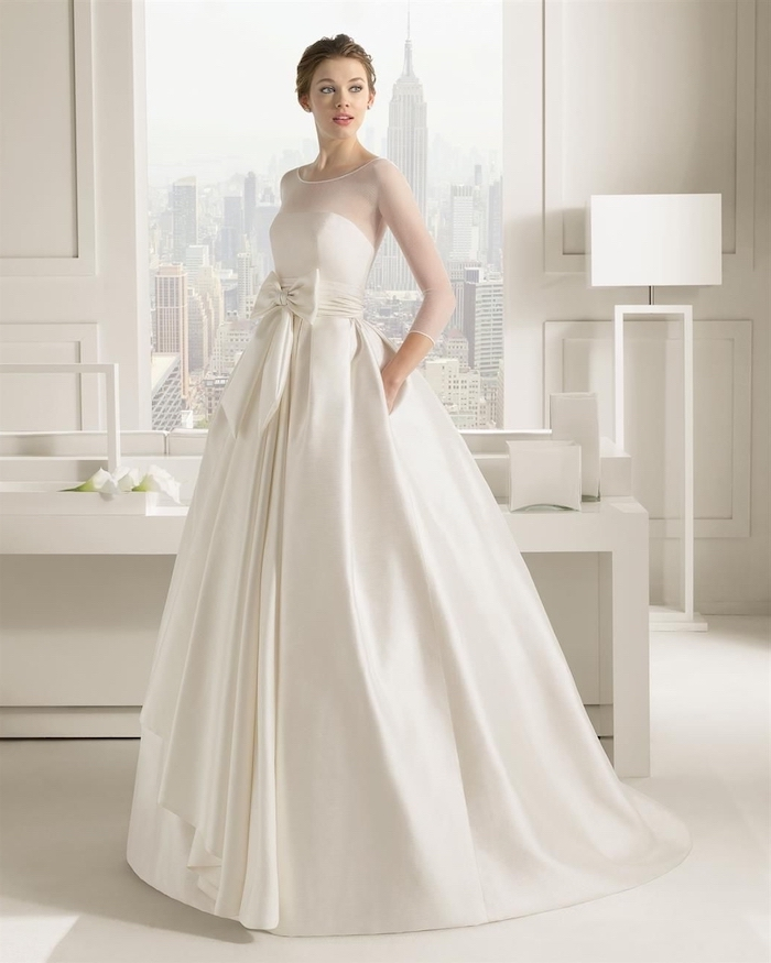 empire state building, satin wedding dresses, brown hair, in a low updo, white furniture