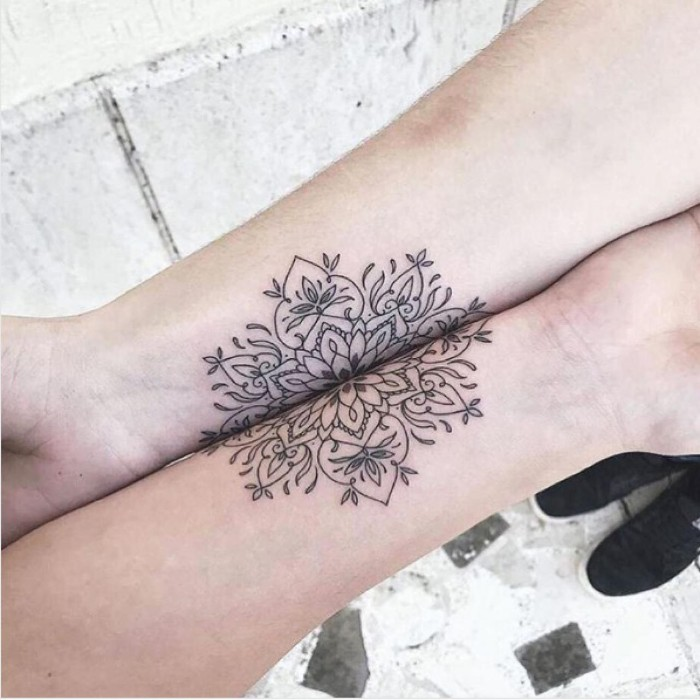 mandala flower, split in two, forearm tattoos, friendship tattoo ideas, white background