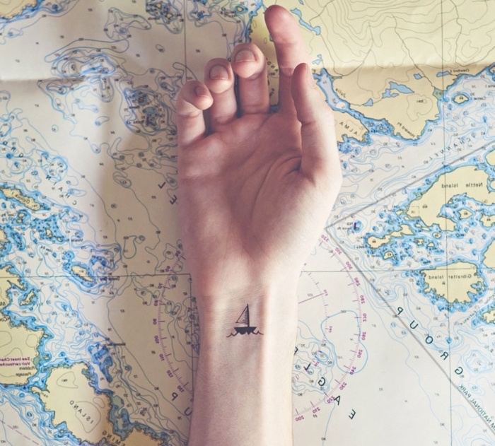 cute simple tattoos, map of the world, wrist tattoo