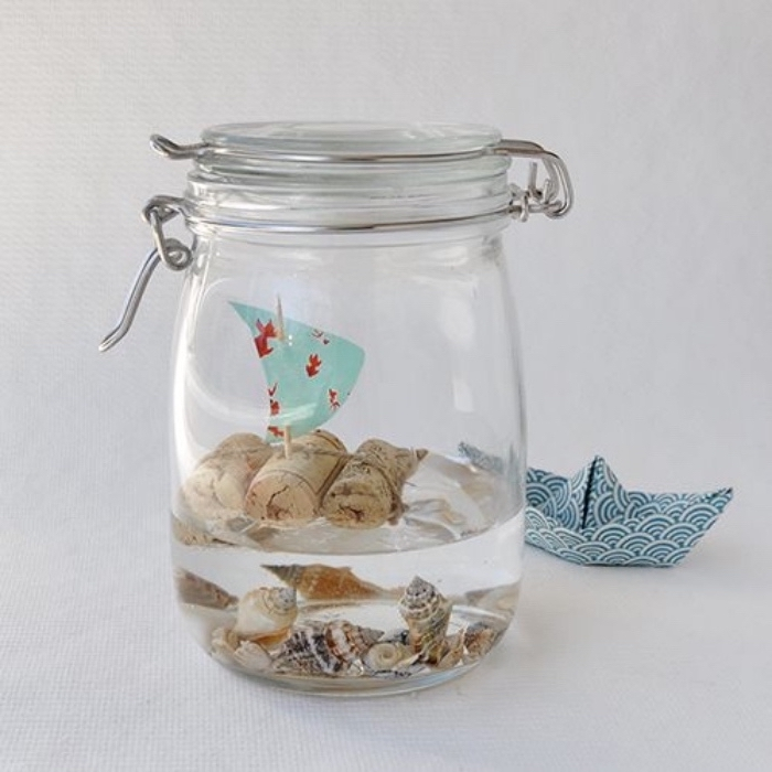 mason jar, filled with water and seashells, creative things to do when bored, small boat, made from corks