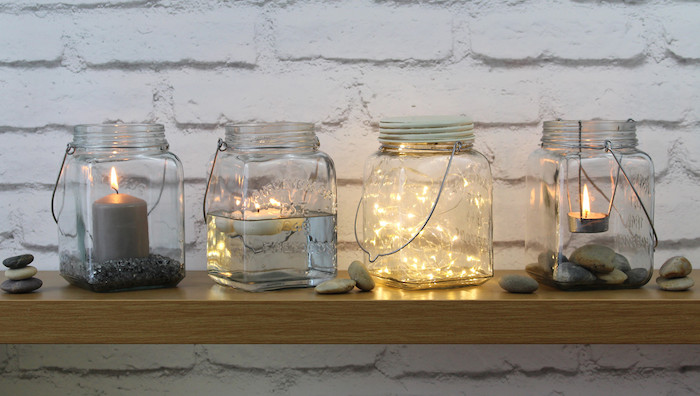 large glass jars, candles inside, fairy lights, diys for your room, wooden shelf, white brick wall