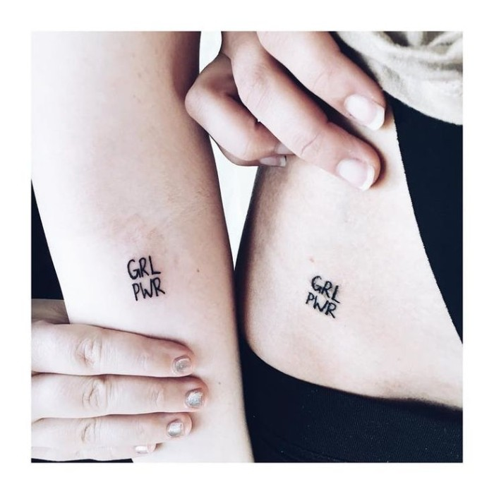 grl pwr, forearm tattoo, hip tattoo, small friendship tattoos, feminist message