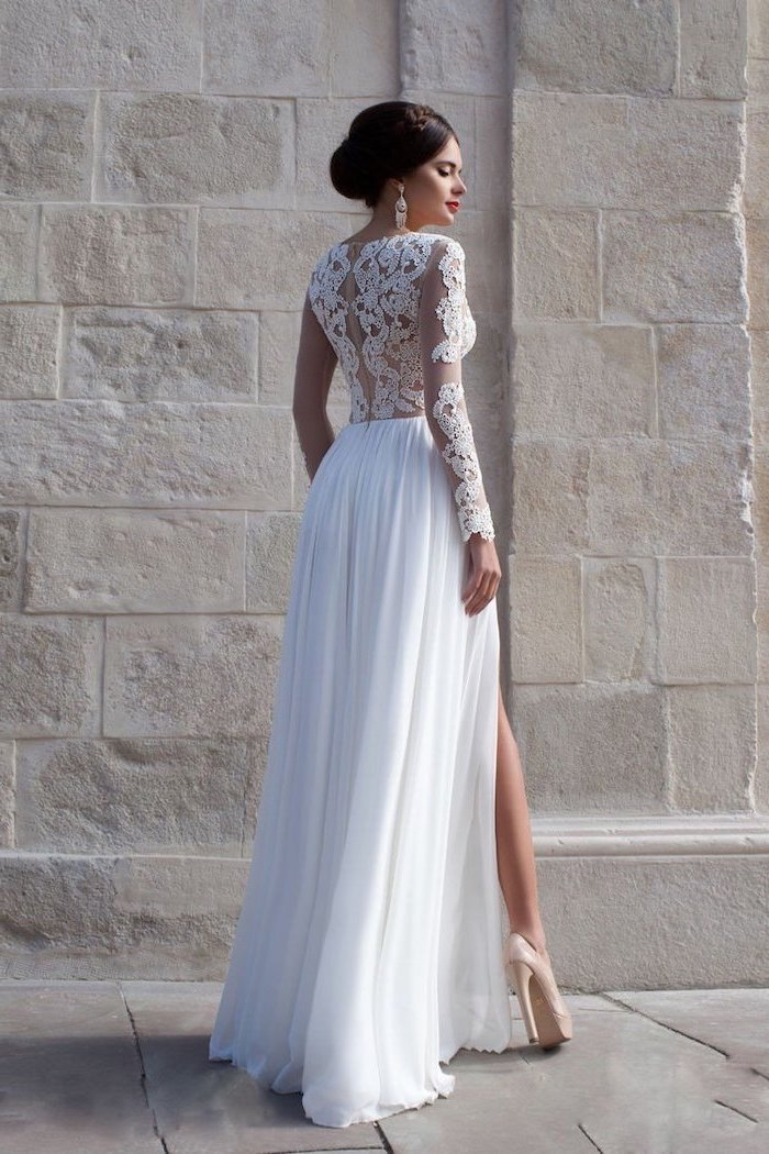 lace top, long sleeves, chiffon skirt with slit, brown hair, in a low updo, short beach wedding dresses