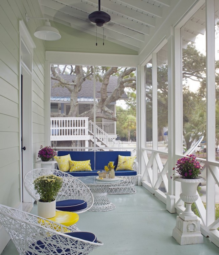 white metal furniture, blue cushions, yellow throw pillows, front door decor ideas, potted flowers