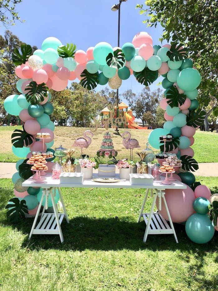 mint green and pink balloons, palm leaves, pink flamingos, cupcake stands, 16th birthday party ideas