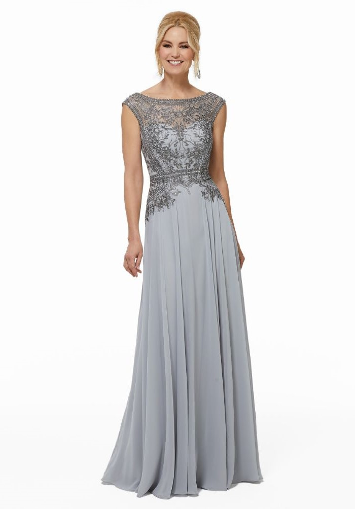 grey chiffon, lace top, navy blue mother of the bride dress, blonde hair, in a low updo, white background