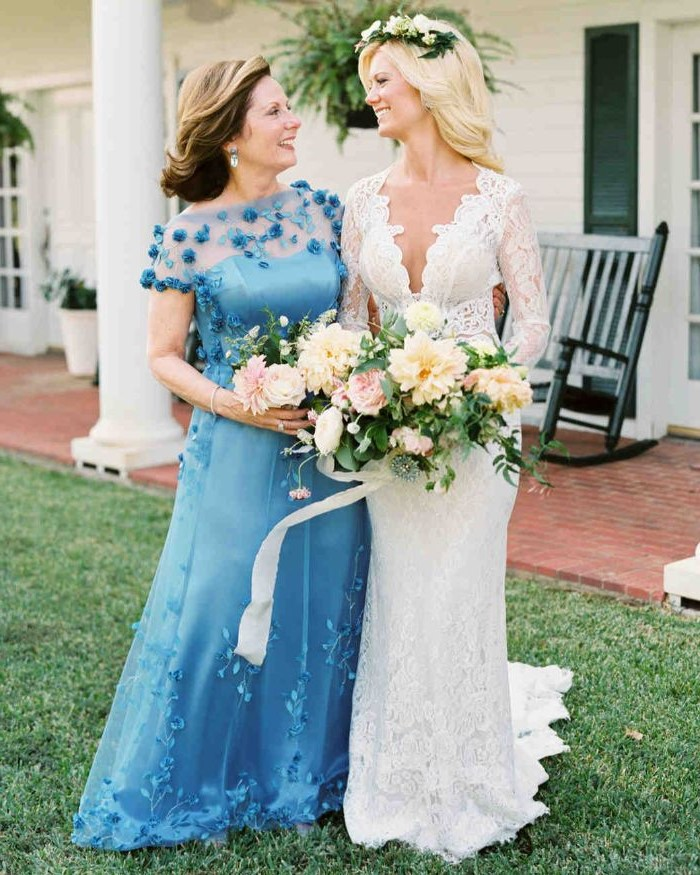 bride and mother, blue dress, navy blue mother of the bride dress, flower bouquet, brown and blonde hair