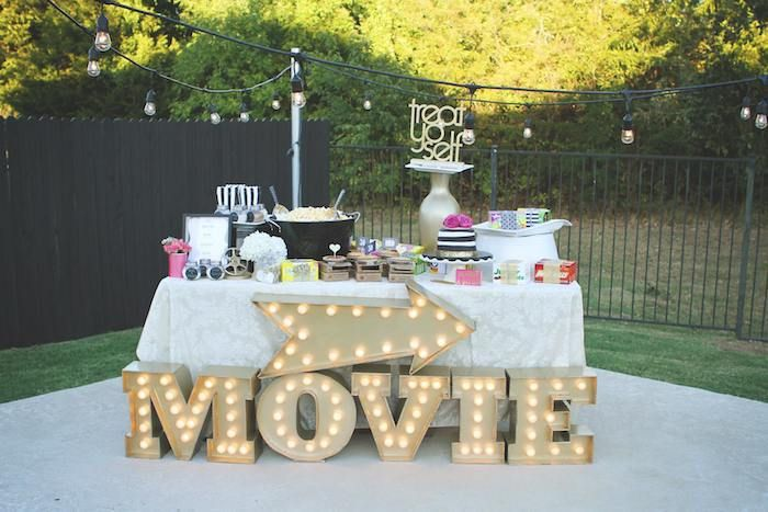 movie lights sign, treat yo self, concessions stand, what should i do for my birthday, large tub of popcorn