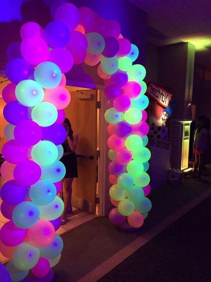 colourful neon, balloon arch, over a large door, what should i do for my birthday