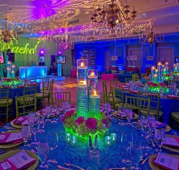 teen birthday party ideas, neon decor, tall candlesticks, neon flower bouquets, large chandelier
