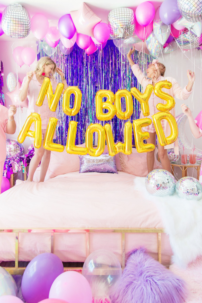 no boys allowed, gold balloons, birthday party ideas for teens, two girls, jumping on a bed