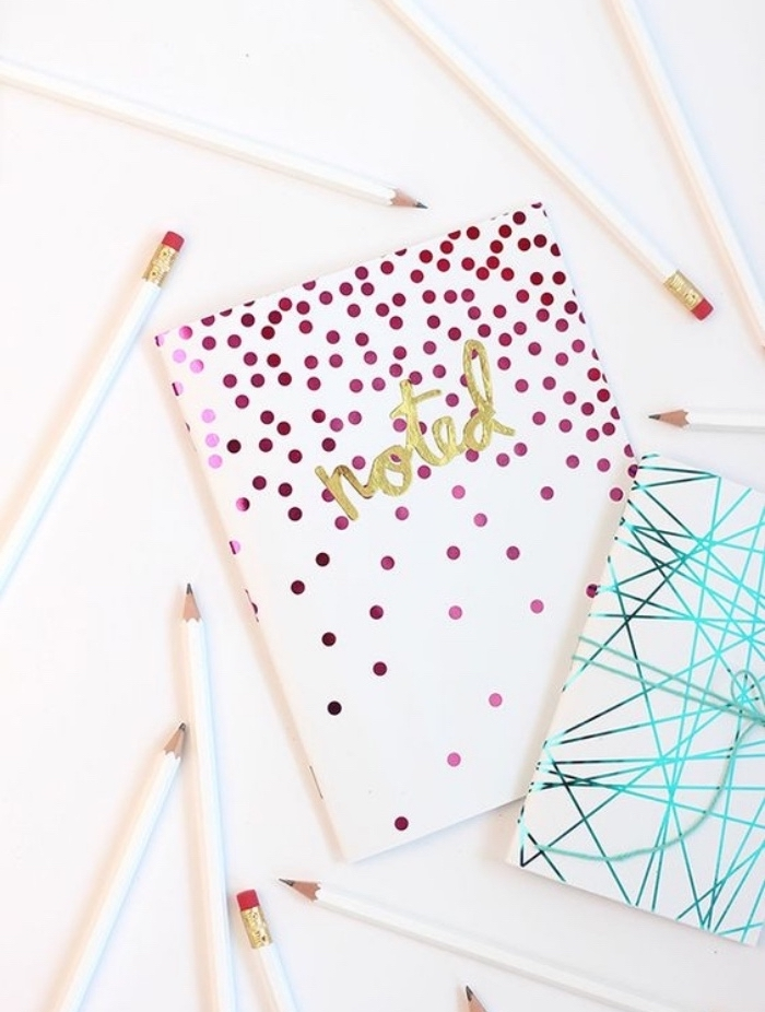 two notebooks, blue and pink decorations, white pencils, diys for your room