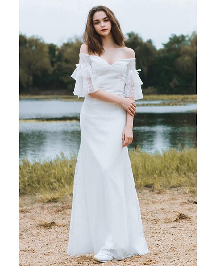 medium brown wavy hair, vintage dress, off the shoulder neckline, bohemian beach wedding dress, white sneakers