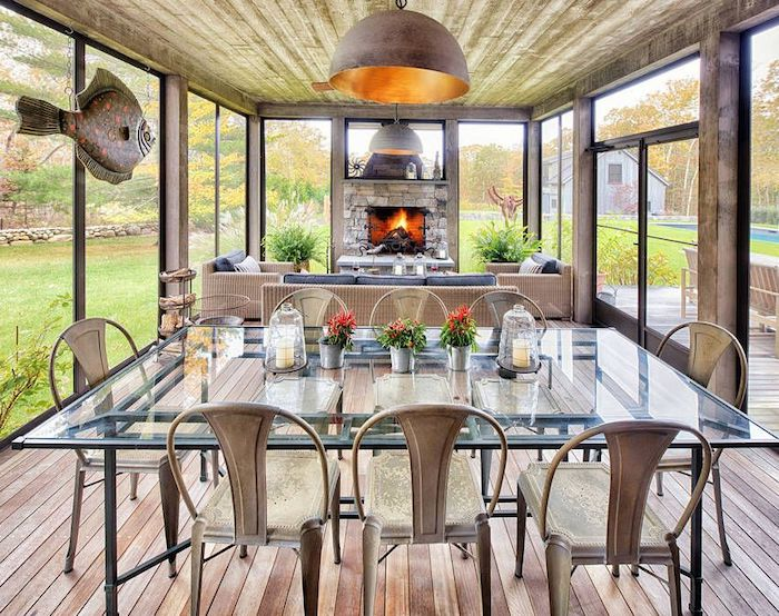 glass sinner table, metal chairs, garden furniture, stone fireplace, screened in, outdoor covered patio