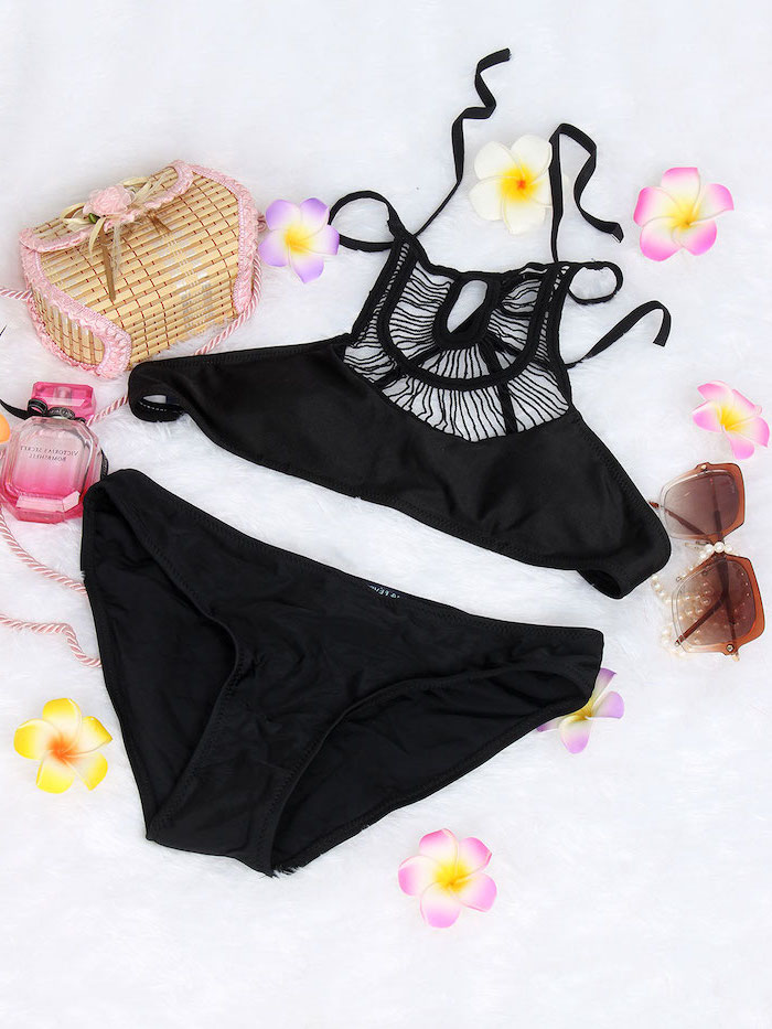black two piece, big girl bathing suits, faux flowers, perfume and bag, white background