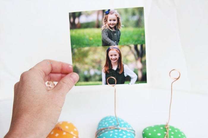 two photos, three rocks, painted in orange, blue and green, brass hooks, photo holder, cool diys