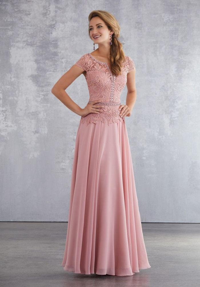pink dress, lace top, chiffon skirt, mother of the bride outfits, long blonde hair, in a ponytail