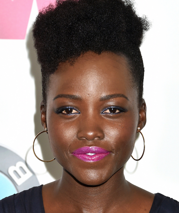 lupita nyong'o, with pink lipstick, black hair, short natural haircuts for black women, hoop earrings