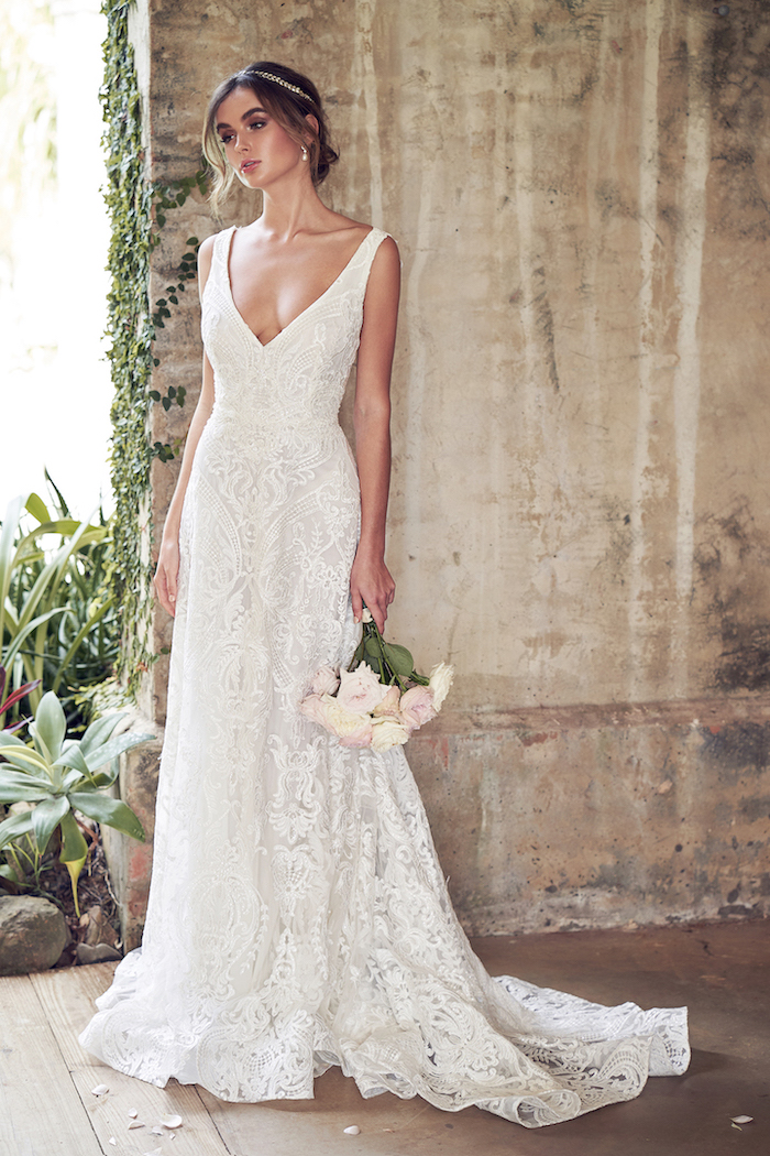 long lace dress, plunging v neckline, short beach wedding dresses, pink and white roses, flower bouquet