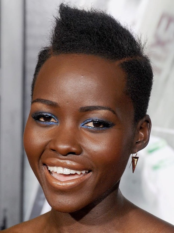 lupita nyong'o, with blue eyeliner, black hair, short natural haircuts for black women, small earrings