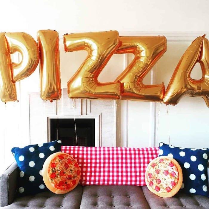 pizza party, gold balloons, summer party themes, pizza throw pillows, blue throw pillows, grey sofa