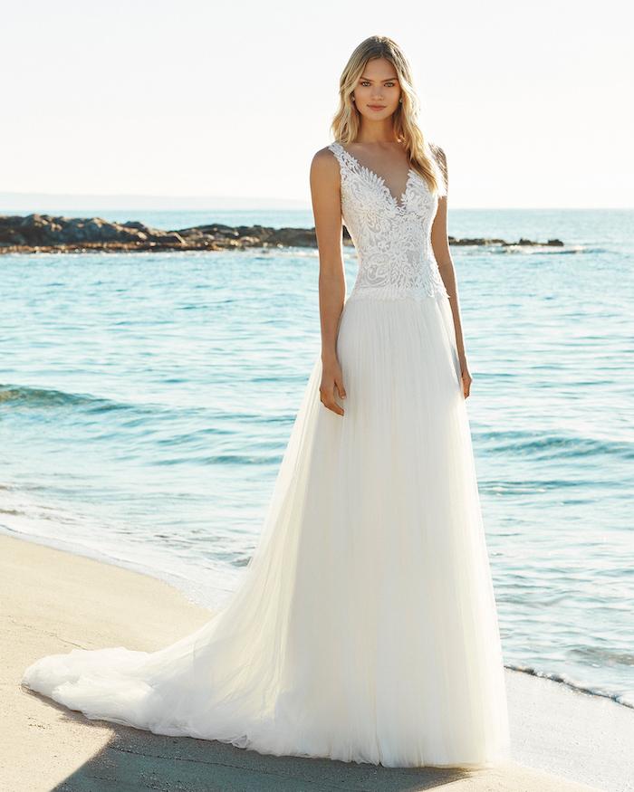 destination wedding dresses, lace corset, tulle skirt, long blonde wavy hair, beach side, ocean waves