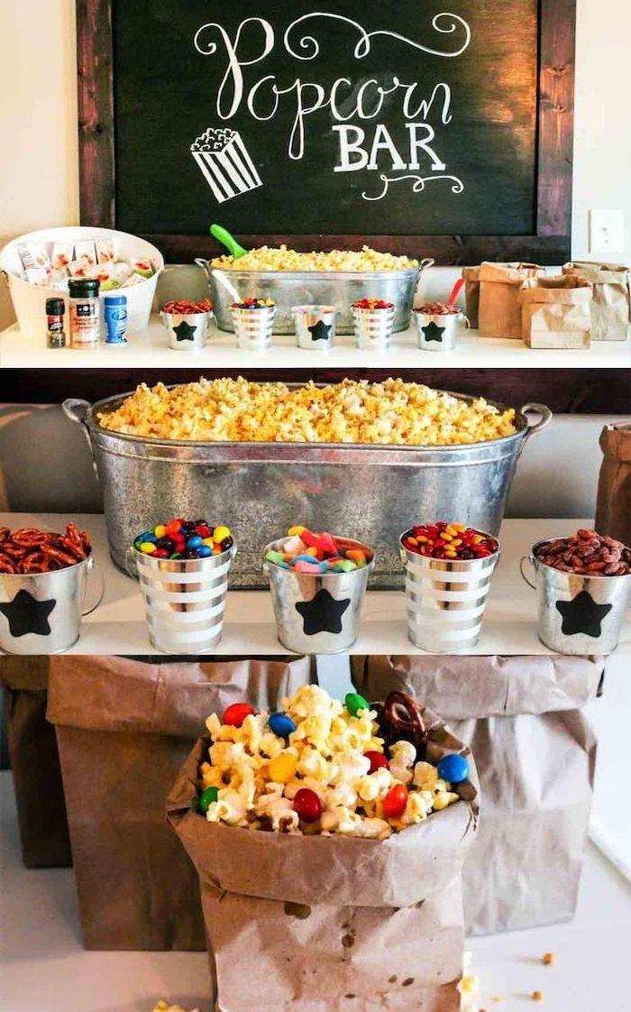 popcorn bar, large tub of popcorn, 16th birthday party ideas, metal cups, full of different toppings