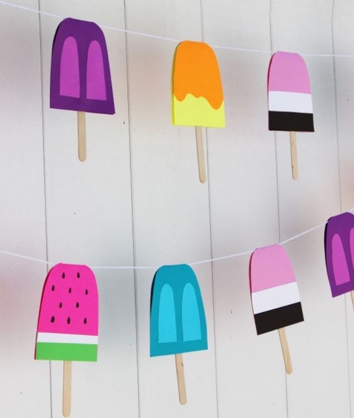 popsicle sticks, hanging garland, in different colours, diy crafts for teens, white wooden wall
