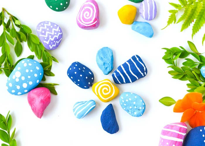 colourful rocks, blue and yellow, purple and pink, diy projects for teens, garden decoration