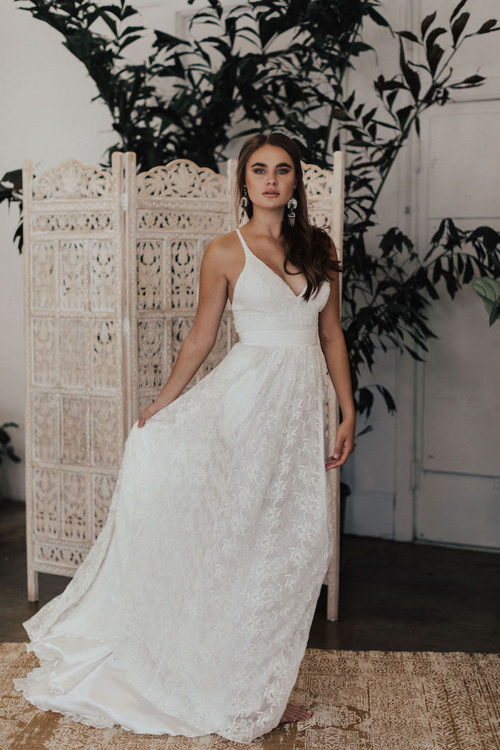 v neckline, lace dress, destination wedding dresses, brown long wavy hair, room divider