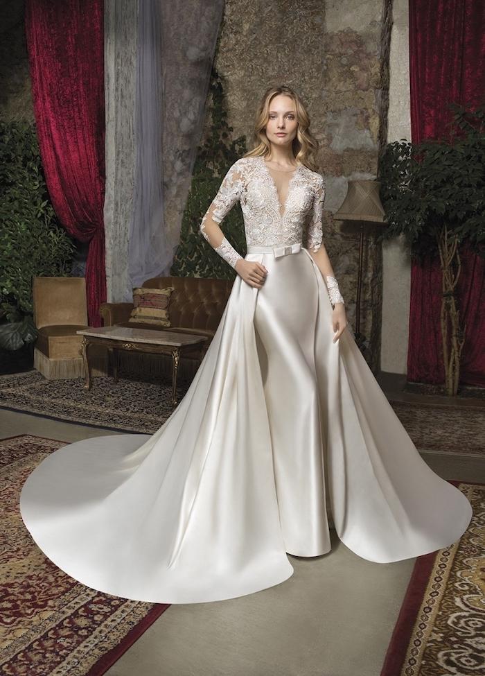 satin wedding dresses, lace top, vintage carpets, long blonde wavy hair, brown velvet sofa