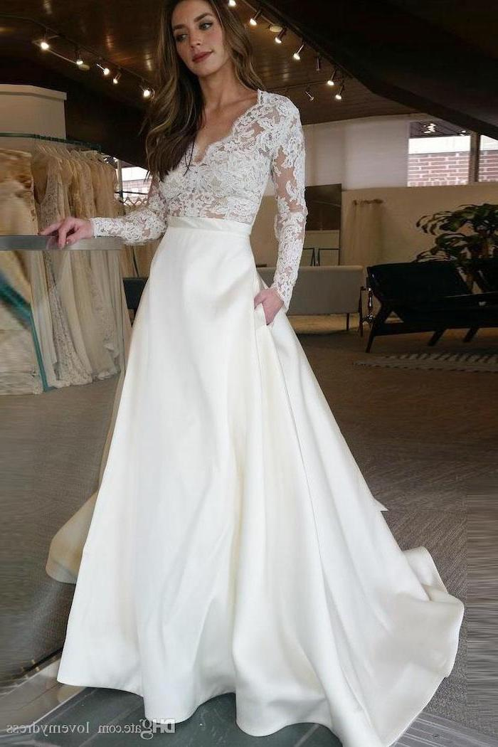 satin bottom, lace top, ball gown wedding dresses with sleeves, v neckline, brown wavy hair