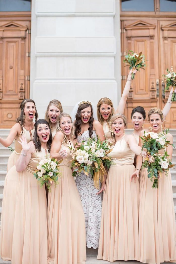 bride in the middle, lace bridesmaid dresses, white flower bouquets, satin top, chiffon skirt