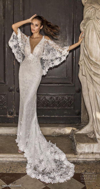 wide sleeves, lace dress, short sleeve wedding dress, black metal door, brown hair, in a ponytail