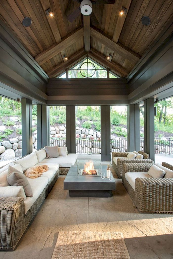 a shaped ceiling, garden furniture, white cushions, small electric fireplace, screened in porch furniture