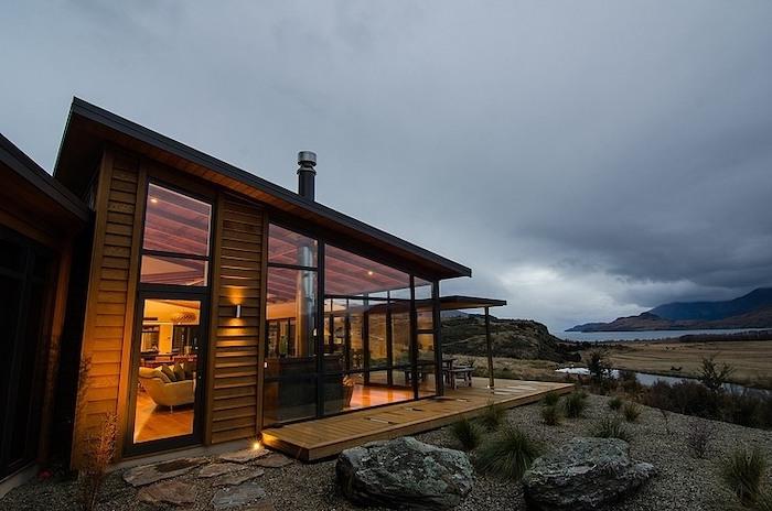 large windows, wooden porch, wooden garden furniture, front porch ideas