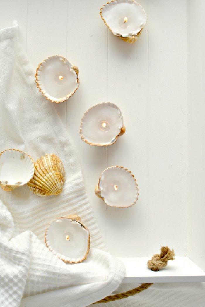 candle holders, made of seashells, cute diys, white towel, wooden shelf
