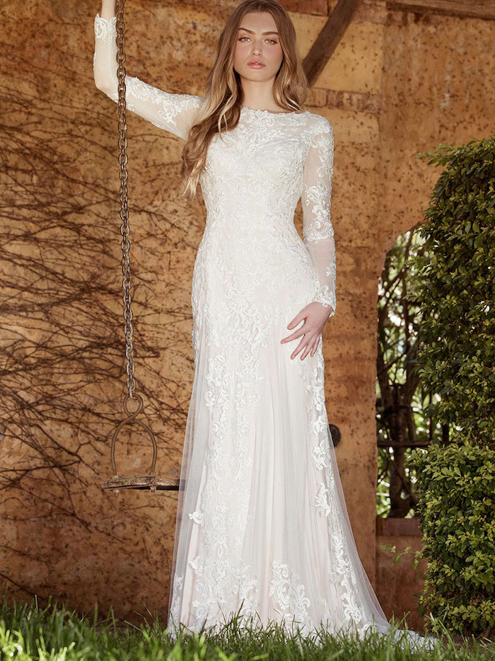 metal swing, blonde wavy hair, ball gown wedding dresses with sleeves, made of lace and chiffon