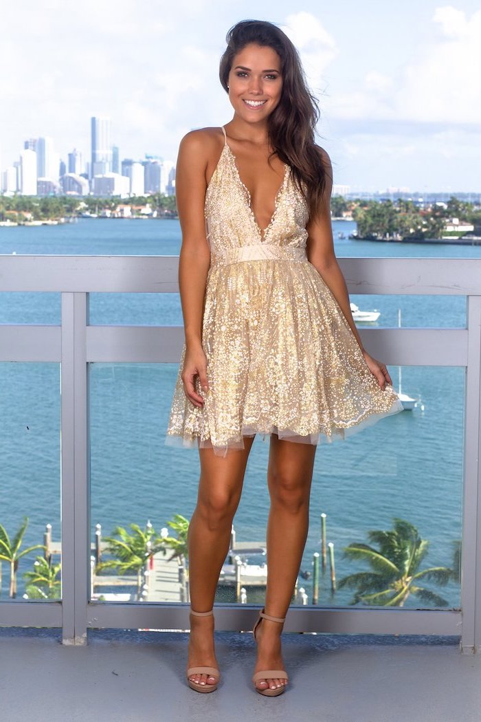 plunging v neckline, wedding bridesmaid dresses, gold short dress, brown wavy hair, nude sandals