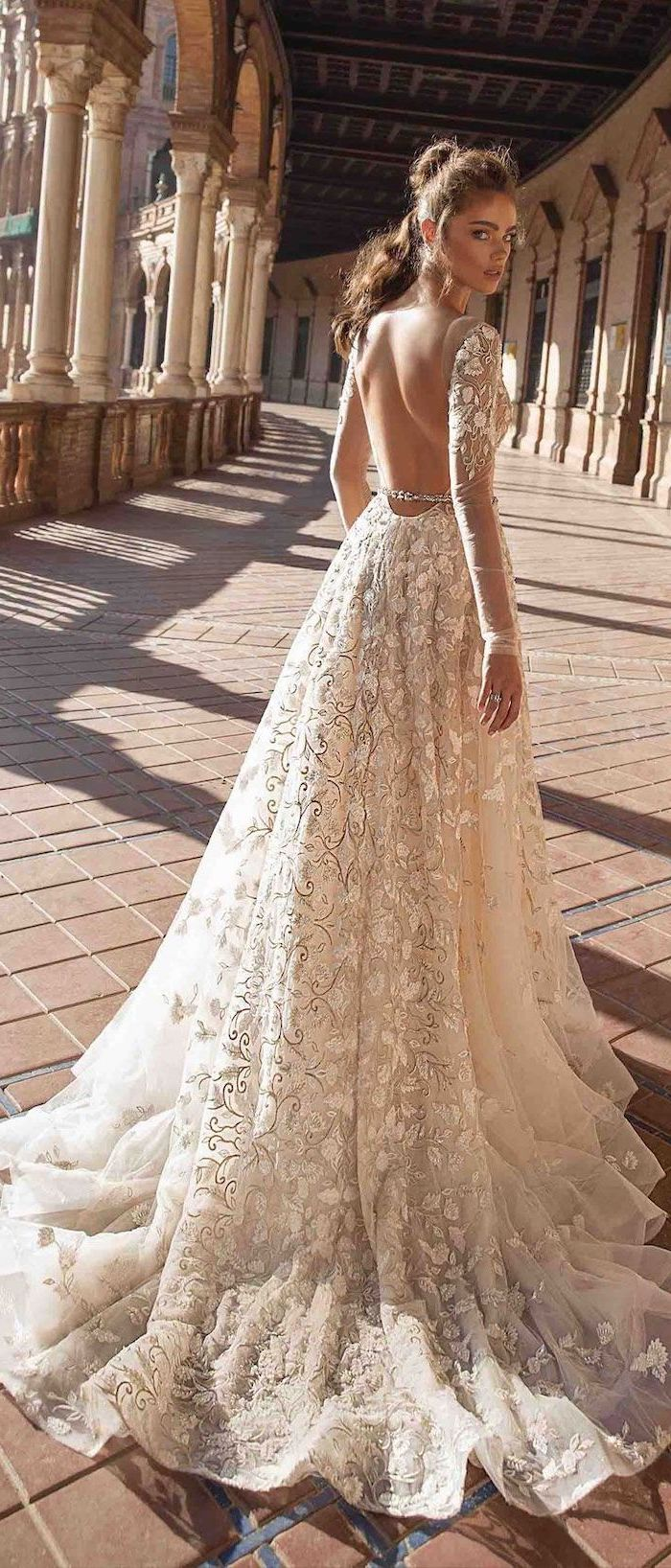long sleeve lace mermaid wedding dress, bare back, long train, brown hair, in a ponytail