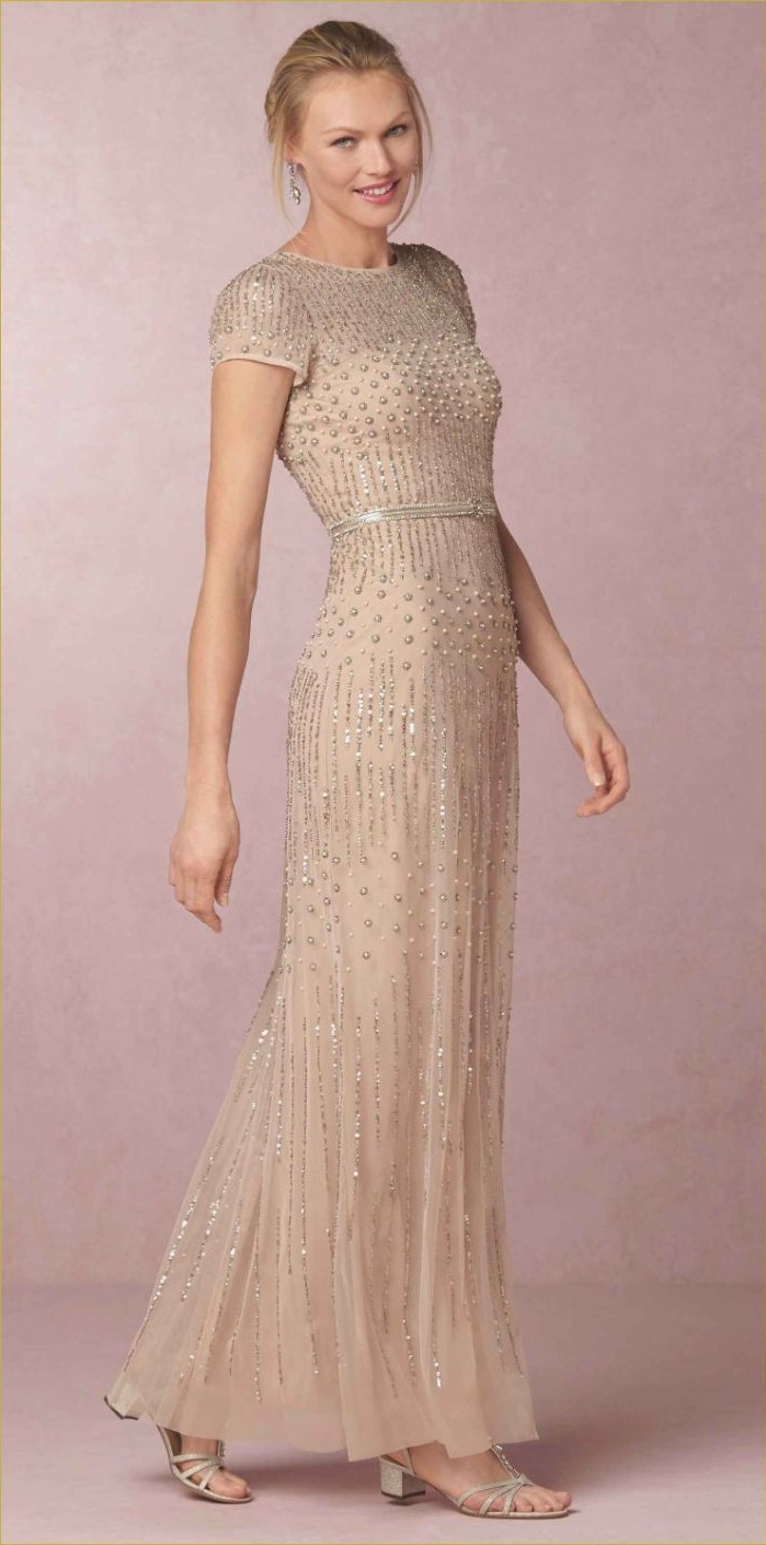 blonde hair, in a low updo, chiffon dress, white sequins, casual mother of he bride dresses, nude sandals