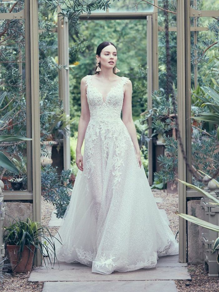 tulle and lace, long white dress, black hair, in a low updo, plus size beach wedding dresses