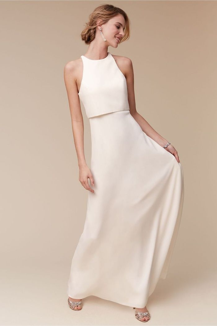 blonde hair, in a low updo, satin dress, two pieces, casual beach wedding dresses, silver sandals