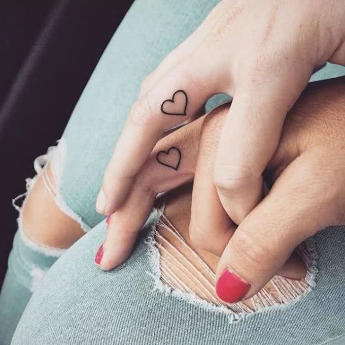 heart outlines, inside finger tattoos, red nail polish, you are my sunshine tattoo, ripped jeans